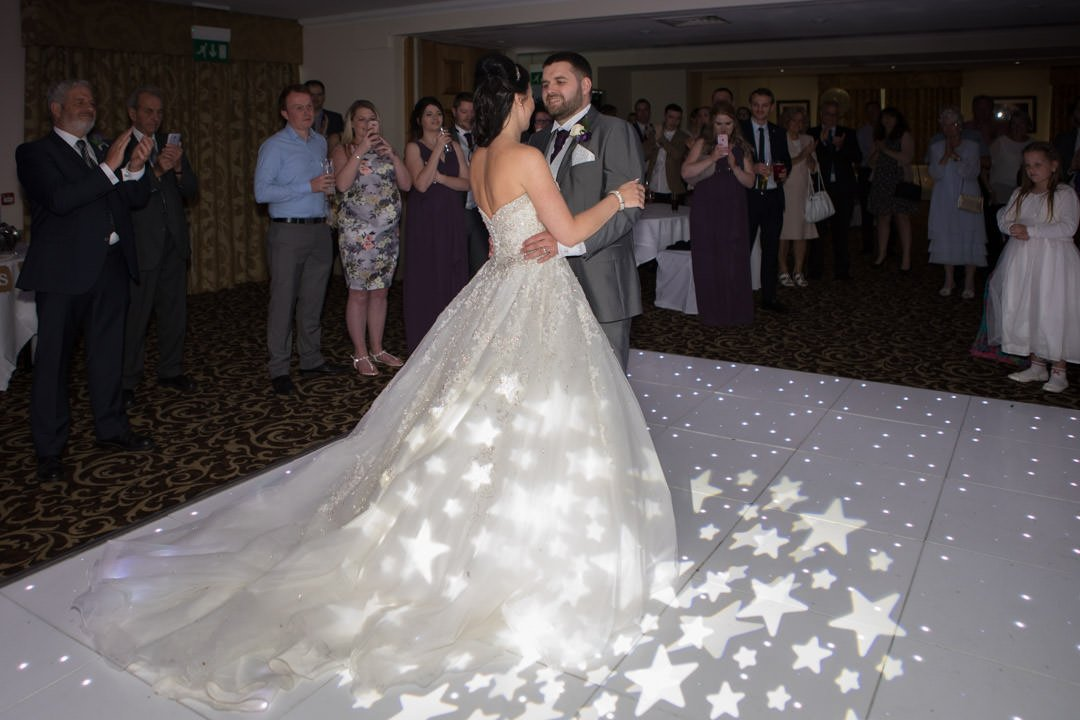 the bride and groom have their first dance at frimley Hall hotel