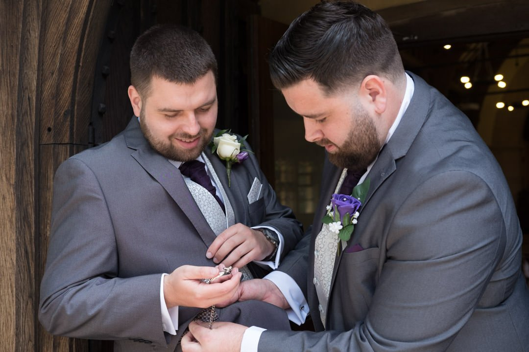 groom and best man before the ceremony at St Andrew's church in Frimley Green