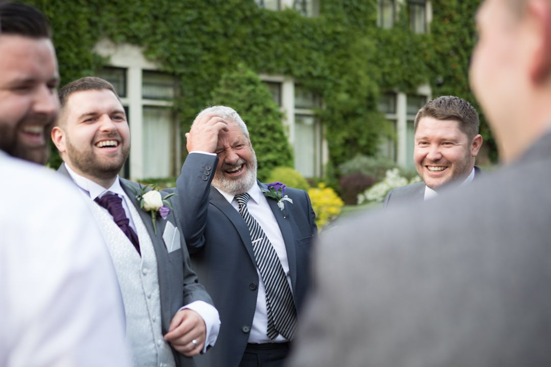 groom and friends relax at frimley Hall hotel
