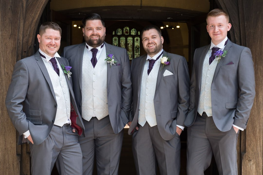 groom and groomsmen before the ceremony at St Andrew's church in frimley Green