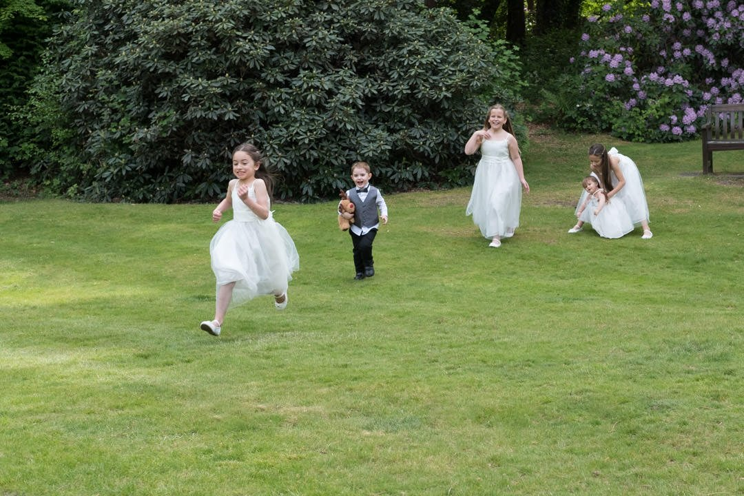 kids play in the gardens at the wedding at Frimley Hall Hotel