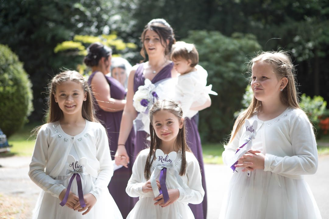 the bridesmaids arrive at church at St Andrew's church in Frimley Green