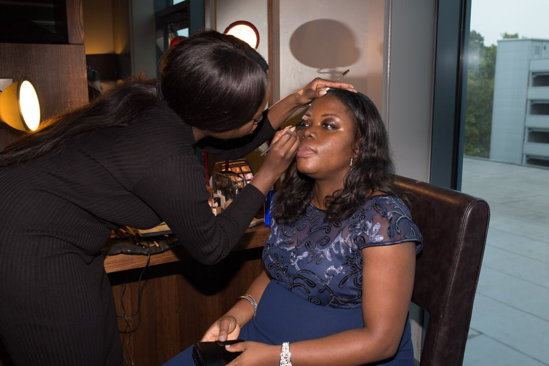 Make up artist does finishing touches for a wedding guest at the Village Hotel