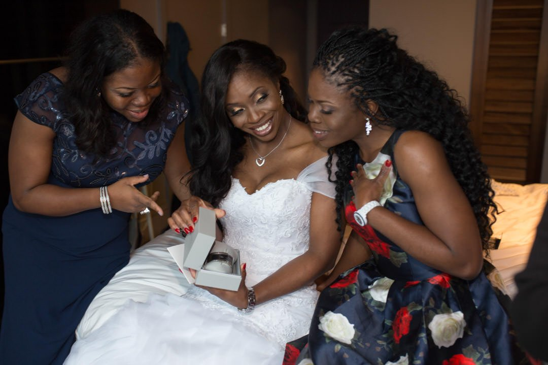 Bride shows her best friends the gift from the groom
