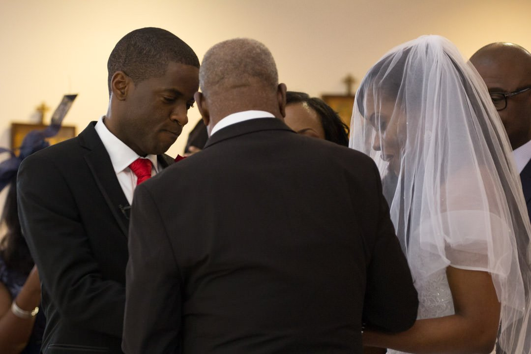 The bride and groom exchange rings in the church