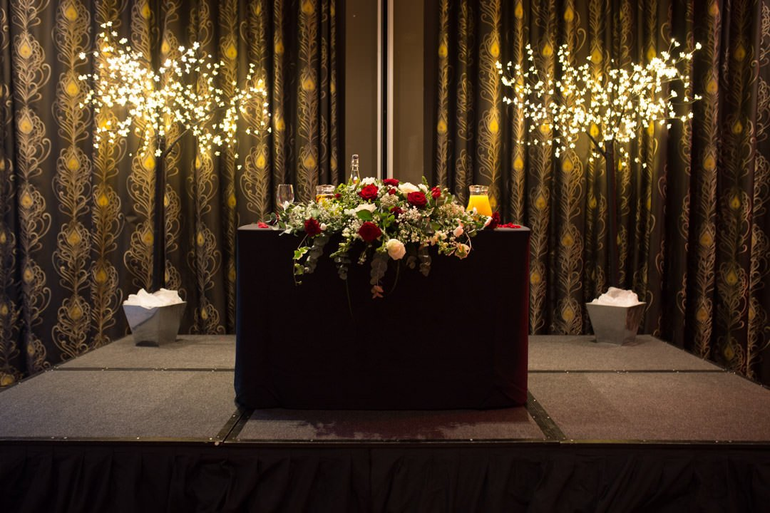 The bride and groom's top table at the Village Hotel, illuminated by a pair of LED trees