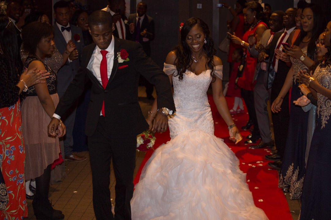 The bride and groom's entrance into the wedding breakfast, dancing as the guests applaud