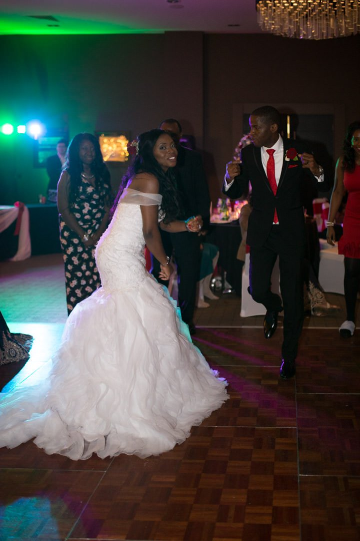 The bride and groom dance together at their Village Hotel wedding in Farnborough