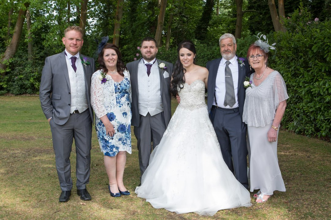 wedding group photo in the gardens at Frimley Hall Hotel