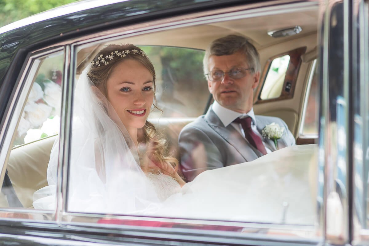 bride arrives at Horsell church for her Woking wedding