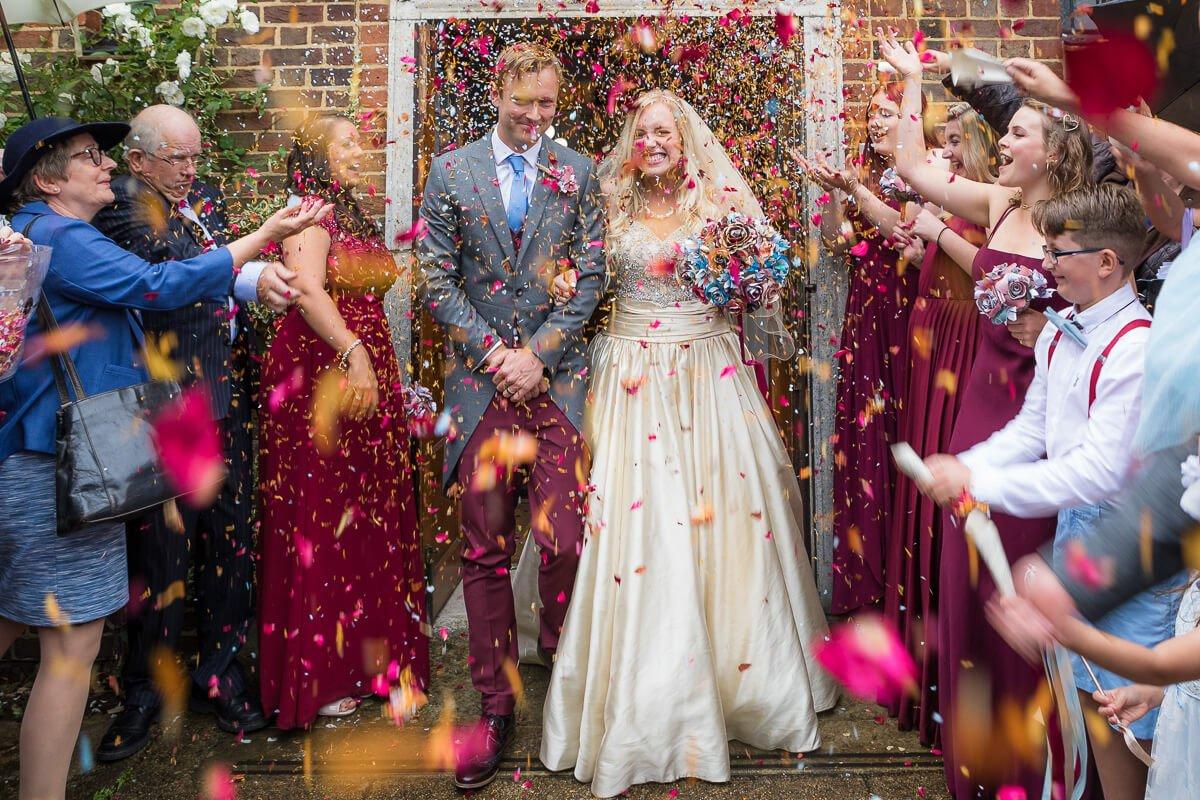 Confetti fun as couple come out of church
